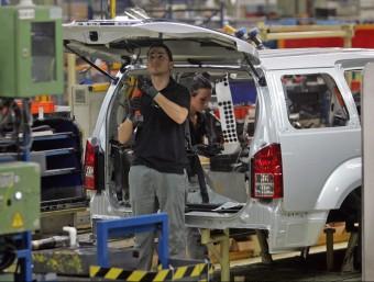 Operaris de la factoria de Nissan a la Zona Franca.  Foto:ARXIU