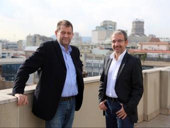 D'esquerra a dreta, Sergi Jiménez i Josep Ginesta després de participar en una trobada conjunta sobre salaris i mercat laboral a L'Econòmic.  Foto:QUIM PUIG