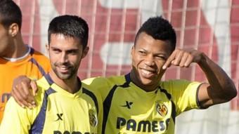 Blázquez i Uche, en un entrenament del de Besalú amb el primer equip groguet Foto:L'ESPORTIU