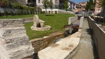 La zona arranjada combina les restes arquitectòniques, el rec, un passatge i una zona enjarcinada. Foto:R. E