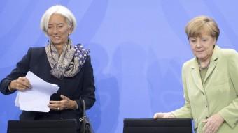 Christine Lagarde, directora gerent de l'FMI, amb Angela Merkel, cancellera alemanya Foto:MAURICIO GAMBARINI / EFE