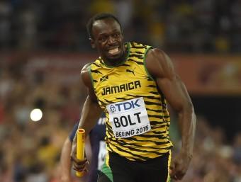 Bolt va completar en el relleu de 4x100 m el seu triplet a Pequín  Foto:AFP