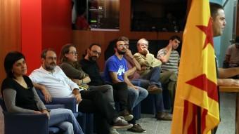 Els futurs diputats i alguns dirigents de la CUP en un moment de la intervenció de Josep Manel Busqueta juanma ramos