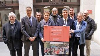 Els organitzadors, ahir a l'Ajuntament de Girona. Foto:ADG