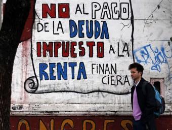 Una pintada contra el pagament del deute, a Argentina.  Foto:ARXIU