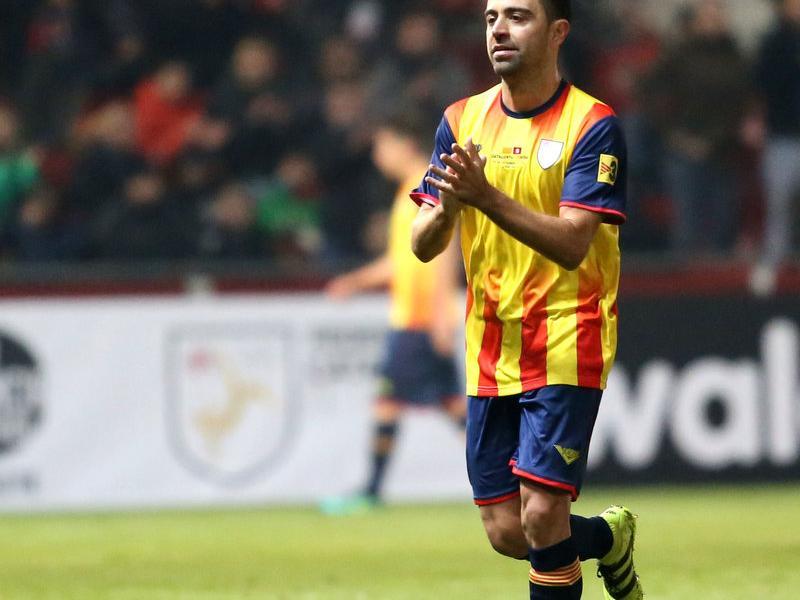 Xavi Hernández en el moment d'abandonar el terreny de joc per ser substituït Foto:QUIM PUIG